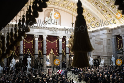 American Flag Photo - Speaker of the United States House of Representatives Nancy Pelosi (Democrat of California) center left walks past the American flag-draped casket of US Representative Elijah Cummings (Democrat of Maryland) during a memorial service in National Statuary Hall at the US Capitol in Washington DC US on Thursday Oct 24 2019 Cummings a key figure in Democrats impeachment inquiry and a fierce critic of US President Donald J Trump died at the age of 68 on October 17 due to complications concerning long-standing health challengesCredit Al Drago  Pool via CNPAdMedia
