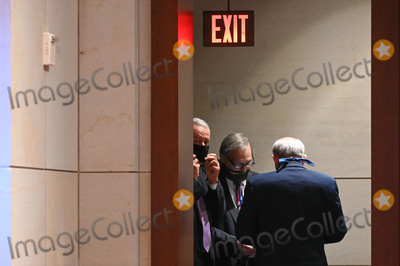 Train Photo - United States House Judiciary Committee members huddle in a doorway during a markup on HR 7120 the Justice in Policing Act of 2020 in Washington DC US on Wednesday June 17 2020 The House bill would make it easier to prosecute and sue officers and would ban federal officers from using choke holds bar racial profiling end no-knock search warrants in drug cases create a national registry for police violations and require local police departments that get federal funds to conduct bias training Credit Erin Scott  Pool via CNPAdMedia