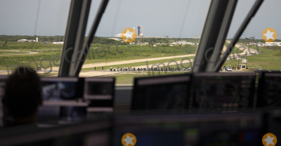 THE WINDOW Photo - In this photo released by the National Aeronautics and Space Administration (NASA) Seen through the windows of firing room four of the Launch Control Center a SpaceX Falcon 9 rocket carrying the companys Crew Dragon spacecraft is launched from Launch Complex 39A on NASAs SpaceX Demo-2 mission to the International Space Station with NASA astronauts Robert Behnken and Douglas Hurley onboard Saturday May 30 2020 at NASAs Kennedy Space Center in Florida The Demo-2 mission is the first launch with astronauts of the SpaceX Crew Dragon spacecraft and Falcon 9 rocket to the International Space Station as part of the agencys Commercial Crew Program The test flight serves as an end-to-end demonstration of SpaceXs crew transportation system Behnken and Hurley launched at 322 pm EDT on Saturday May 30 from Launch Complex 39A at the Kennedy Space Center A new era of human spaceflight is set to begin as American astronauts once again launch on an American rocket from American soil to low-Earth orbit for the first time since the conclusion of the Space Shuttle Program in 2011Mandatory Credit Joel Kowsky  NASA via CNPAdMedia