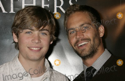 Paul Walker Photo - 30 November 2013 - Santa Clarita California - Paul Walker died at the age of 40 in a car accident while attending a charity event for his organization Reach Out Worldwide The accident occurred in Santa Clarita when Walkers Porsche lost control and crashed into a tree The car burst into flames and exploded File Photo 09 October 2006 Beverly Hills California - Paul Walker (right) and brother Flags of Our Fathers Los Angeles Premiere held at the Academy of Motion Picture Arts and Sciences Photo Credit Russ ElliotAdMedia