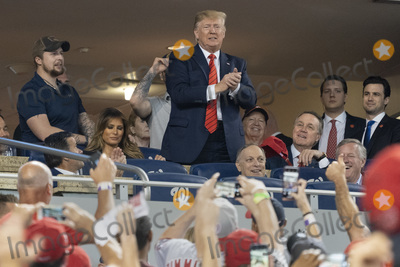 TI Photo - United States President Donald J Trump participates in a moment to salute the military during game five of the World Series at Nationals Park in Washington DC on October 27 2019 The Washington Nationals and Houston Astros are tied at two games going into tonights game Those also pictured include US Representative Andy Biggs (Republican of Arizona) US Representative Kevin Brady (Republican of Texas) US Senator David Perdue (Republican of Georgia) and US Representative Mark Meadows (Republican of North Carolina) Credit Chris Kleponis  Pool via CNPAdMedia