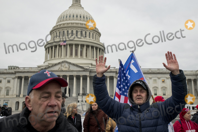 Sounds Photo - People pray to the sound of a Bile passage over a bullhorn as a small crowd of President Trump supporters gather on the west side of the US Capitol in the hours before the Electoral votes are to be counted during a joint session of the United States Congress to certify the results of the 2020 presidential election in the US House of Representatives Chamber in the US Capitol in Washington DC on Wednesday January 6 2021 Congressional Republicans have announced they are going to challenge the Electoral votes from up to six swing statesCredit Rod Lamkey  CNPAdMedia