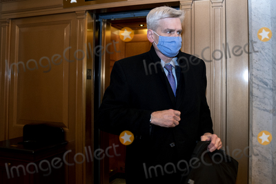 Bill Cassidy Photo - Senator Bill Cassidy a Republican from Louisiana wears a protective mask while departing the US Capitol in Washington DC US on Saturday Feb 13 2021 Donald Trumps second impeachment trial ended in a not guilty verdict on a vote of 57-43 short of the two-thirds majority requiredCredit Stefani Reynolds - Pool via CNPAdMedia