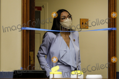 Alexandria Ocasio-Cortez Photo - United States Representative Alexandria Ocasio-Cortez (Democrat of New York) waits to enter a US House Oversight and Reform Committee hearing on slowdowns at the Postal Service ahead of the November elections on Capitol Hill in Washington US August 24 2020 Credit Tom Brenner  Pool via CNPAdMedia