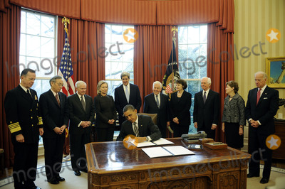 Robert gates Photo - United States President Barack Obama signs the New START Treaty during a ceremony in the Oval Office of the White House with from left Joint Chiefs of Staff Chairman Admiral Mike Mullen US Secretary of Energy Steven Chu US Secretary of Defense Robert Gates US Secretary of State Hillary Rodham Clinton US Senator John Kerry (Democrat of Massachusetts) US Senator Richard Lugar (Republican of Indiana) US Senator Dianne Feinstein (Democrat of California) US Senator Thad Cochran (Republican of Mississippi) US Senator Jeanne Shaheen (Democrat of New Hampshire) and US Vice President Joe Biden Credit Leslie E Kossoff  Pool via CNPAdMedia