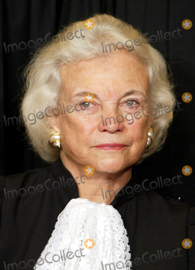 Mark Wilson Photo - AdMediaAssociate Justice of the United States Supreme Court Sandra Day OConnor poses during a group portrait session with the members of the US Supreme Court at the Supreme Court Building in Washington DC on December 5 2003 OConnor made history as the first woman on the high court when former US President Ronald Reagan nominated her  She took her seat September 25 1981Credit Mark Wilson  Pool via CNP