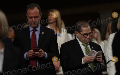 Adam Schiff Photo - Lead House impeachment manager Rep Adam Schiff (D-CA) types on his phone as he and fellow manager and Judiciary Committee Chairman Jerry Nadler (D-NY) stands beside him reading a pocket copy of the US Constitution as they wait for the start of US President Donald Trumps State of the Union address to a joint session of the US Congress in the House Chamber of the US Capitol in Washington US February 4 2020 Credit Leah Millis  Pool via CNPAdMedia