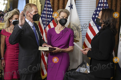 Kamala Harris Photo - US Vice President Kamala Harris right swears in Bill Nelson left former Democratic Senator from Florida and administrator of the National Aeronautics and Space Administration (NASA) alongside his wife Grace Nelson holding the bible in the Eisenhower Executive Office Building in Washington DC US on May 3 2021 The Senate confirmed Nelson on April 29 and had served as the chairman and ranking member of the Senate subcommittee that oversees NASA Credit Oliver Contreras  Pool via CNPAdMedia