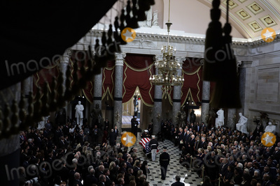 Alex Wong Photo - The flag-draped casket of United States Representative Elijah Cummings (Democrat of Maryland) is carried by honor guard to the Statuary Hall of the US Capitol for a memorial service October 24 2019 in Washington DC Rep Cummings passed away on October 17 2019 at the age of 68 from complications concerning longstanding health challenges Credit Alex Wong  Pool via CNPAdMedia