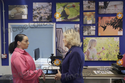 Train Photo - 06022020 - Camilla Duchess of Cornwall speaks with Marsida a prisoner being trained in the Max Spielmann Academy an onsite shop where inmates are trained in up-to-date photographic industry techniques during a visit to Her Majestys HM Prison Downview in Sutton south London During the visit to the womens prison Thursday the Duchess met staff and inmates and learnt about the prisons rehabilitation programmes Photo Credit ALPRAdMedia