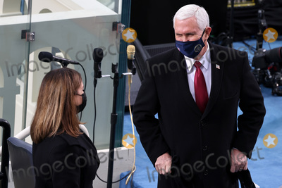 Mike Pence Photo - WASHINGTON DC - JANUARY 20 Vice President Mike Pence and Karen Pence arrive at the inauguration of US President-elect Joe Biden on the West Front of the US Capitol on January 20 2021 in Washington DC  During todays inauguration ceremony Joe Biden becomes the 46th president of the United States (Photo by Tasos KatopodisGetty Images)AdMedia