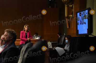 alaska Photo - United States Senator Lisa Murkowski (Republican of Alaska) stands to get a better view of Director of the National Institute of Allergy and Infectious Diseases at the National Institutes of Health Dr Anthony Faucis video testimony during the US Senate Committee for Health Education Labor and Pensions hearing to examine COVID-19 and Safely Getting Back to Work and Back to School on Tuesday May 12 2020 Credit Toni L Sandys  Pool via CNPAdMedia