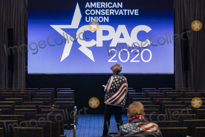 American Flag Photo - OXON HILL Md - FEBRUARY 27 Attendees wearing American flag jackets sit in front of one of the large screens in the back of the ballroom at the Conservative Political Action Conference CPAC 2020 in Oxon Hill Md on Thursday February 27 2020Credit Samuel Corum  CNPAdMedia