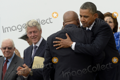Jimmy Carter Photo - US President Barack Obama (R) hugs civil rights leader and Democratic Representative from Georgia John Lewis (2-R)after Lewis delivered remarks as former US President Jimmy Carter (L) and former US President Bill Clinton (2-L) look on during the Let Freedom Ring commemoration event at the Lincoln Memorial in Washington DC USA 28 August 2013 The event was held to commemorate the 50th anniversary of the 28 August 1963 March on Washington led by the late Dr Martin Luther King Jr where he famously gave his I Have a Dream speechCredit Michael Reynolds  Pool via CNPAdMedia