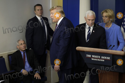 Devo Photo - United States President Donald J Trump leaves as Director of the National Institute of Allergy and Infectious Diseases at the National Institutes of Health Dr Anthony Fauci left looks on after a press briefing on the Coronavirus COVID-19 pandemic with members of the Coronavirus Task Force at the White House in Washington DC on March 27 2020 Behind the President are US Vice President Mike Pence and US Secretary of Education Betsy DeVosCredit Yuri Gripas  Pool via CNPAdMedia