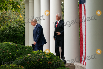 The White Photo - United States President Donald J Trump walks out to the Rose Garden with US Vice President Mike Pence to give an update on the Nations Coronavirus Testing Strategy at the White House September 28 2020 in Washington DC  Credit Ken Cedeno  Pool via CNPAdMedia