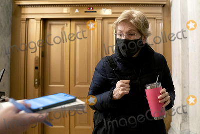 Donald Trump Photo - Senator Elizabeth Warren a Democrat from Massachusetts wears a protective mask while arriving to the US Capitol in Washington DC US on Saturday Feb 13 2021 The Senate approved 55-45 a request to consider calling witnesses in the second impeachment trial of Donald Trump a move that may extend the trial that was expected to end within hoursCredit Stefani Reynolds - Pool via CNPAdMedia