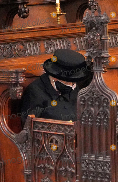 Queen Photo - Photo Must Be Credited Alpha Press 073074 17042021Queen Elizabeth II during the funeral of Prince Philip Duke of Edinburgh at St Georges Chapel in Windsor Castle in Windsor Berkshire No UK Rights Until 28 Days from Picture Shot Date AdMedia