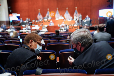 Train Photo - United States Representative Karen Bass (Democrat of California) speaks with Mark Meadows Assistant to the President and Chief of Staff during a US House Judiciary Committee markup on HR 7120 the Justice in Policing Act of 2020 in Washington DC US on Wednesday June 17 2020 The House bill would make it easier to prosecute and sue officers and would ban federal officers from using choke holds bar racial profiling end no-knock search warrants in drug cases create a national registry for police violations and require local police departments that get federal funds to conduct bias training Credit Erin Scott  Pool via CNPAdMedia