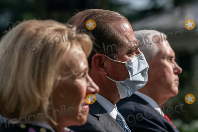 The White Photo - United States Secretary of Health and Human Services (HHS) Alex Azar center listens during an update by US President Donald J Trump gives on the Nations Coronavirus Testing Strategy in the Rose Garden of the White House September 28 2020 in Washington DC  Credit Ken Cedeno  Pool via CNPAdMedia