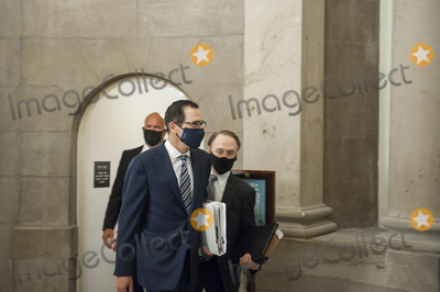 The Used Photo - United States Secretary of the Treasury Steven T Mnuchin arrives for a meeting with US Senate Minority Leader Chuck Schumer (Democrat of New York) Speaker of the US House of Representatives Nancy Pelosi (Democrat of California) and White House Chief of Staff Mark Meadows regarding the COVID-19 economic stimulus package at the US Capitol in Washington DC Thursday August 6 2020 Credit Rod Lamkey  CNPAdMedia