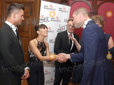 Aljaz Skorjanec Photo - Prince William Duke of Cambridge greets Aljaz Skorjanec and Janette Manrara with Jason Donovan during the Child Bereavement 25th birthday gala dinner at Kensington Palace in London HRH is a patron of Child Bereavement UK The charity works to help families to rebuild their lives after the devastation of child bereavement Photo Credit ALPRAdMedia