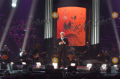 Grammy Awards Photo - 20 March 2020 - Kenny Rogers whose legendary music career spanned nearly six decades has died at the age of 81 Rogers was inducted to the Country Music Hall of Fame in 2013 He had 24 No 1 hits and through his career more than 50 million albums sold in the US alone He was a six-time Country Music Awards winner and three-time Grammy Award winner Some of his hits included Lady Lucille Weve Got Tonight Islands In The Stream and Through the Years His 1978 song The Gambler inspired multiple TV movies with Rogers as the main character File Photo June 9 2004 Nashville TN USA Singer KENNY ROGERS during CMT 100 Greatest Love Songs Telecast Taping held at Gaylord Entertainment Center Photo by Laura FarrAdMedia