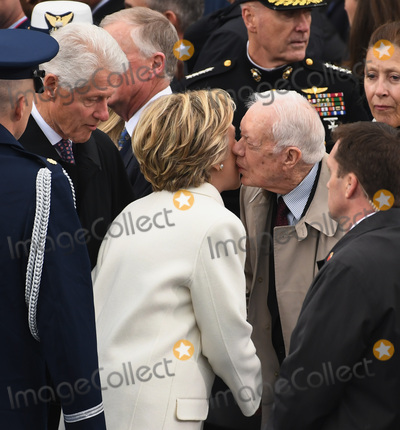 Bill Clinton Photo - Former President Jimmy Carter kisses Hillary Clinton on the cheek as she and former President Bill Clinton arrive for the Inauguration Ceremony of President Donald Trump on the West Front of the US Capitol on January 20 2017 in Washington DC  Trump became the 45th President of the United States Photo Credit Kevin DietschCNPAdMedia
