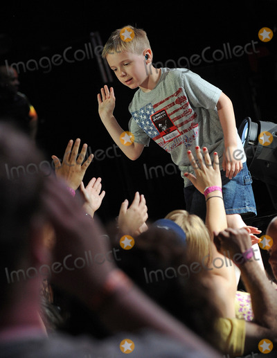 Avery Molek Photo - 01 June 2013 - Burgettstown PA - Drummer 6 year old AVERY MOLEK greets fans after his performance with country music artist BRAD PAISLEY on a stop on his Beat This Summer Tour held at the First Niagara Pavilion  Photo Credit Jason L NelsonAdMedia