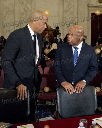 Alabama Photo - United States Senator Cory Booker (Democrat of New Jersey) left and US Representative John Lewis (Democrat of Georgia) speak prior to appearing on a panel testifying before the United States Senate Judiciary Committee on the nomination of US Senator Jeff Sessions (Republican of Alabama) to be Attorney General of the United States on Capitol Hill in Washington DC on Wednesday January 11 2017  Senator Booker became the first sitting senator in US history to testify against a fellow sitting senator at a cabinet confirmation hearingCredit Ron Sachs  CNPAdMedia