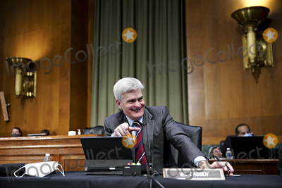 Barack Obama Photo - United States Senator Bill Cassidy (Republican of Louisiana) smiles while speaking during a Senate Veterans Affairs Committee confirmation hearing for Denis McDonough US secretary of Veterans Affairs (VA) nominee for US President Joe Biden in Washington DC US on Wednesday Jan 27 2021 As Barack Obamas chief of staff McDonough oversaw the VAs overhaul in response to its 2014 wait-time scandal and previously served as a deputy national security adviserCredit Sarah Silbiger  Pool via CNPAdMedia