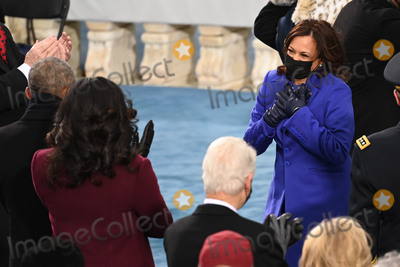 Michelle Obama Photo - US Vice President-elect Kamala Harris (R) meets former US First Lady Michelle Obama and former US President Barack Obama before US President-elect Joe Biden is sworn in as the 46th US President on January 20 2021 at the US Capitol in Washington DC - Biden a 78-year-old former vice president and longtime senator takes the oath of office at noon (1700 GMT) on the US Capitols western front the very spot where pro-Trump rioters clashed with police two weeks ago before storming Congress in a deadly insurrection (Photo by Saul LOEB  POOL  AFP)AdMedia
