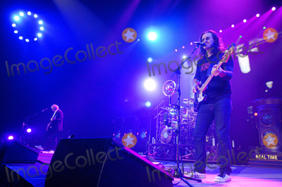 Alex Lifeson Photo - 19 April 2011 - Hamilton Ontario Canada - RUSH  Guitarist Alex Lifeson drummer Neil Peart and singerbassist Geddy Lee of RUSH perform onstage at Copps Coliseum for the Time Machine Tour Photo Credit Brent PerniacAdMedia