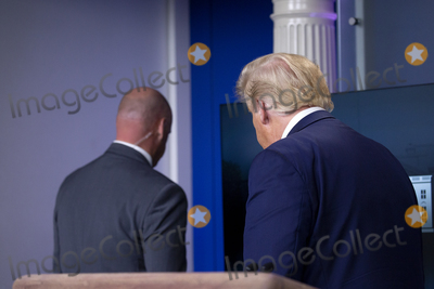 Usher Photo - United States President Donald J Trump is escorted out of a news conference in the James S Brady Press Briefing Room at the White House in Washington DC US on Monday August 10 2020  Trump was abruptly ushered out of the briefing room by Secret Service after shots were reportedly fired in the area  Credit Stefani Reynolds  CNPAdMedia