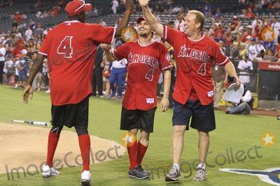 Al Joyner Photo - 3 July 2011 - Anaheim California - Al Joyner Jason Ritter Steve Garveys Celebrity Softball Game for ALS Research Held At Angels Stadium Photo Credit Kevan BrooksAdMedia