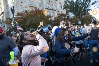 Vice President Joe Biden Photo - People celebrate drink champagne and dance in the streets near the White House in the hours after Democratic presidential candidate and former Vice President Joe Biden was elected president in Washington DC Saturday November 7 2020 Credit Rod Lamkey  CNPAdMedia