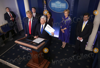 Front Row Photo - United States Vice President Mike Pence delivers remarks on the COVID-19 (Coronavirus) pandemic alongside President Donald Trump and members of the Coronavirus Task Force in the Brady Press Briefing Room at the White House in Washington DC March 18 2020 in Washington DC Left to right front row United States President Donald J Trump Vice President Pence  Back row left to right US Secretary of Veterans Affairs (VA) Robert Wilkie Seema Verma Administrator Centers for Medicare and Medicaid Services Dr Deborah L Birx White House Coronavirus Response Coordinator and US Secretary of Defense Dr Mark T EsperCredit Kevin Dietsch  Pool via CNPAdMedia