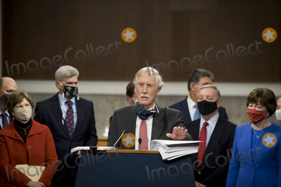 Angus King Photo - United States Senator Angus King Jr (Independent of Maine) joins a bipartisan group of US Senators announcing the legislative text of the two bipartisan bicameral COVID-19 emergency relief bills that propose to provide up to 908 billion in emergency relief on Capitol Hill in Washington DC on Monday December 14 2020  The first will allocate 748 billion for more PPP assistance and an unemployment benefit and a second 160 billion bill to provide aid for state and local governments and liability protections for businessesCredit Rod Lamkey  CNP