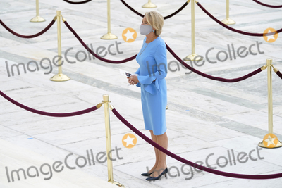 Devo Photo - United States Secretary of Education Betsy DeVos pays respects as Justice Ruth Bader Ginsburg lies in repose under the Portico at the top of the front steps of the US Supreme Court building on Thursday Sept 24 2020 in Washington Ginsburg 87 died of cancer on Sept 18Credit Andrew Harnik  Pool via CNPAdMedia