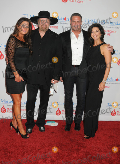 Troy Gentry Photo - 27 February 2017 - Nashville Tennessee - Jennifer Belcher Eddie Montgomery of Montgomery Gentry Troy Gentry of Montgomery Gentry and Angie Gentry TJ Martell Foundation 9th Annual Nashville Honors Gala  held at the Omni Hotel Photo Credit Laura FarrAdMedia