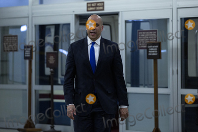 Booker Photo - United States Senator Cory Booker (Democrat of New Jersey) walks through the Senate Subway at the United States Capitol in Washington DC US on Wednesday March 25 2020  The Senate voted to pass a two trillion dollar Coronavirus Stimulus Package after days of delays and negotiations  Credit Stefani Reynolds  CNPAdMedia