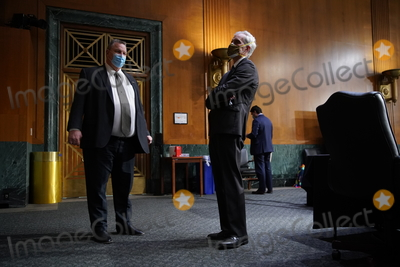 Barack Obama Photo - Denis McDonough US secretary of Veterans Affairs (VA) nominee for US President Joe Biden right and United States Senator Jon Tester (Democrat of Montana) and ranking member of the Senate Veterans Affairs Committee wear protective masks while talking before a confirmation hearing in Washington DC US on Wednesday Jan 27 2021 As Barack Obamas chief of staff McDonough oversaw the VAs overhaul in response to its 2014 wait-time scandal and previously served as a deputy national security adviser Credit Sarah Silbiger  Pool via CNPAdMedia