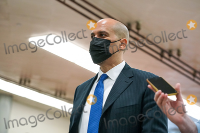 Cory Booker Photo - Sen Cory Booker (D-NJ) returns to the Capitol as from a dinner break during the second day of the impeachment trial of former President Donald Trump on Wednesday February 10 2021Credit Greg Nash - Pool via CNPAdMedia