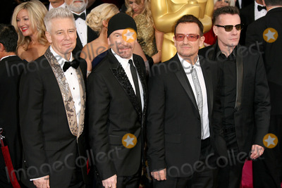 Adam Clayton Photo - 02 March 2014 - Hollywood California - Adam Clayton The Edge Bono and Larry Mullen Jr U2 86th Annual Academy Awards held at the Dolby Theatre at Hollywood  Highland Center Photo Credit AdMedia