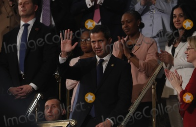 Juanes Photo - Venezuelas opposition leader Juan Guaido waves as US President Donald Trump delivers his State of the Union address to a joint session of the US Congress in the House Chamber of the US Capitol in Washington US February 4 2020 Credit Leah Millis  Pool via CNPAdMedia