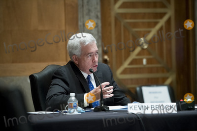 The Faces Photo - Former Assistant Director for Intelligence Federal Bureau of Investigation Kevin R Brock responds to questions as he appears before a Senate Committee on Homeland Security and Governmental Affairs hearing to examine Congressional oversight in the face of Executive Branch and media suppression focusing on the case study of Crossfire Hurricane in the Dirksen Senate Office Building in Washington DC Thursday December 3 2020 Credit Rod Lamkey  CNPAdMedia