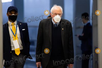 Bernie Sanders Photo - Senator Bernie Sanders I-VT walks on Capitol Hill in Washington Saturday Feb 13 2021 before the fifth day of the second impeachment trial of former President Donald TrumpCredit Graeme Jennings - Pool via CNPAdMedia