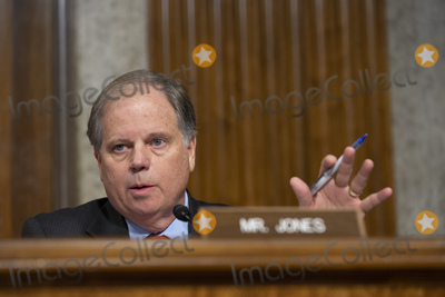 Alabama Photo - United States Senator Doug Jones (Democrat of Alabama) speaks during the nomination hearing of James McPherson nominee to be Under Secretary Of The Army and Charles Williams nominee to be Secretary of the Navy for Energy Installations and Environment before the United States Senate Committee on Armed Services at the United States Capitol in Washington DC US on Thursday January 16 2020Credit Stefani Reynolds  CNPAdMedia