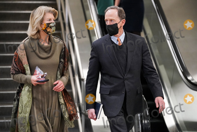 Lisa Murkowski Photo - Sen Lisa Murkowski (R-Alaska) speaks to Sen Robert Casey (D-Pa) as they leave the Capitol after the second day of the impeachment trial of former President Donald Trump on Wednesday February 10 2021Credit Greg Nash - Pool via CNPAdMedia