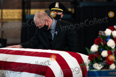 The Used Photo - United States Capitol Police officer Ken Shaver who was also injured in the April 2nd car attack at the Capitol center pays his respects to the late US Capitol Police officer William Billy Evans as he lies in honor in the Rotunda of the US Capitol in Washington DC on April 13th 2020Credit Anna Moneymaker  Pool via CNPAdMedia